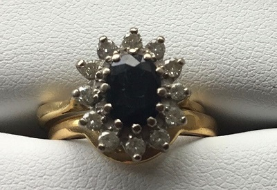 Fitted Wedding Ring next to Sapphire and Diamond Engagement Ring
